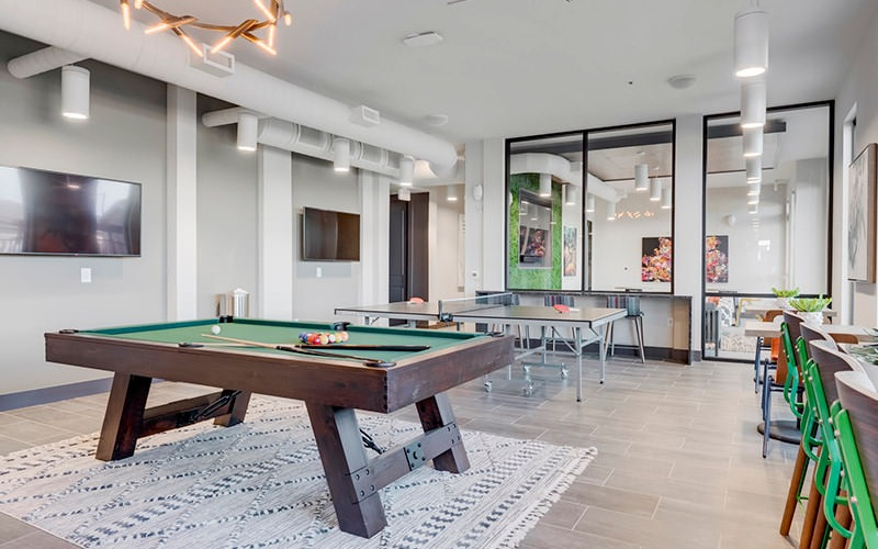 billiards and ping pong tables in spacious, bright clubroom